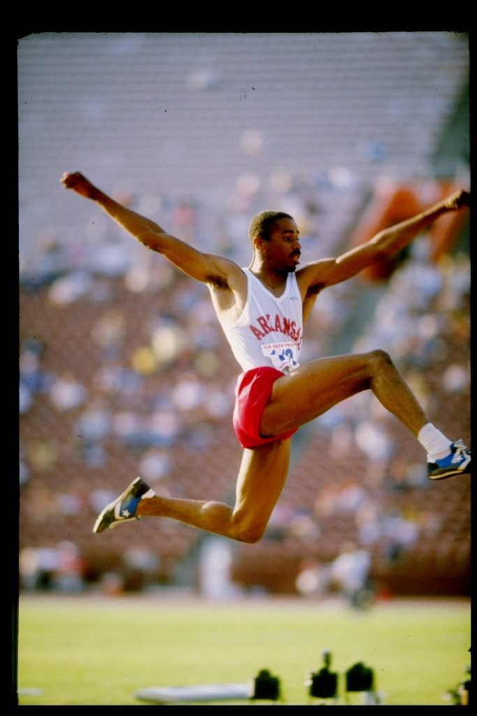 1984: Mike Conley sails through the air in a triple jump event during the United States Olympic Trials. Mandatory Credit: Tony Duffy /Allsport